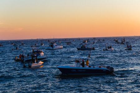 dozens: Dozens of fishing ski-boats waiting for start gun on ocean waters