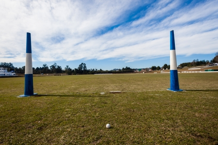 Equestrian polo fields ball goal posts on blue day Stock Photo