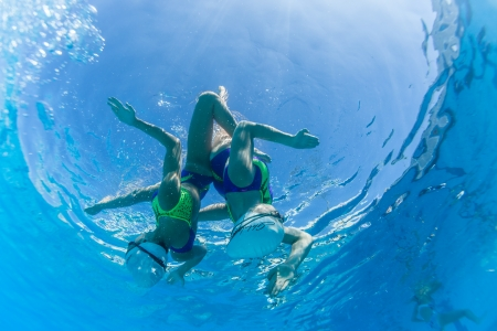 Aquatic Synchronized swimming girls pairs dance underwater surface programs at nationals championships