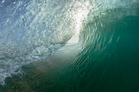 Hollow tunnel wave inside out swimming surfing view