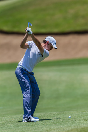 Professional Tommy Fleetwood swings and strikes his ball at the European pga Volvo Golf Champions tournament at Durban Country club South Africa