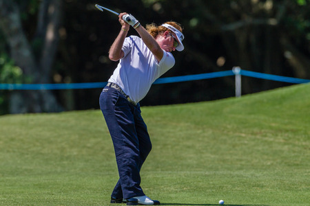 Professional Miguel Angel Jimenez swings and strikes his ball at the European pga Volvo Golf Champions tournament at Durban Country club South Africa