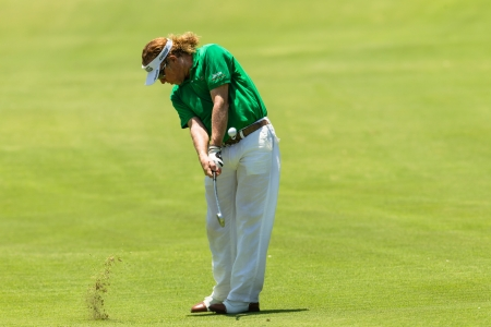 Professional Golfer Miguel Angel Jimenez swings to strike ball at European PGA Tournament Volvo Golf Champions Tournament play action at Durban Country Club  January 2014 South Africa Editorial