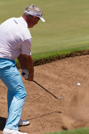 country club: Professional Golfer Darren Clarke sand shots to strike ball at European PGA Tournament Volvo Golf Champions Tournament play action at Durban Country Club  January 2014 South Africa Editorial