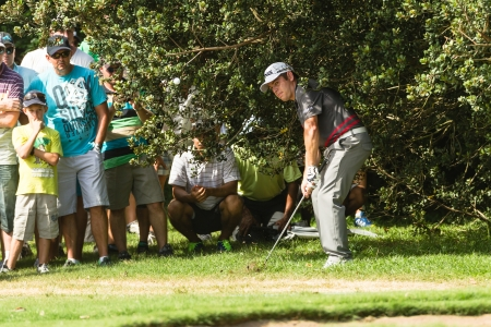 scores: Professional Louis Oosthuizen chips strike ball at European PGA Tournament Volvo Golf Champions Tournament play action at Durban Country Club  January 2014 South Africa