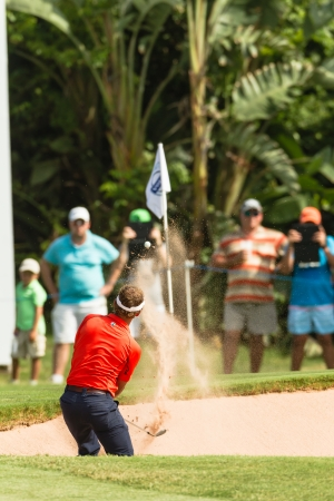 country club: Professional Golfer Joost Luiten sand shot to strike ball at European PGA Tournament Volvo Golf Champions Tournament play action at Durban Country Club  January 2014 South Africa