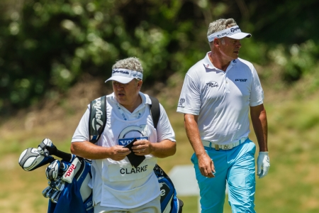 darren: Professional Golfer Darren Clarke and Caddy walks to  ball at European PGA Tournament Volvo Golf Champions Tournament play action at Durban Country Club  January 2014 South Africa