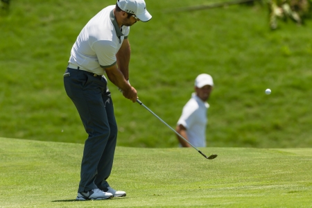 casey: Professional Golfer Paul Casey chips to strike ball at European PGA Tournament Volvo Golf Champions Tournament play action at Durban Country Club  January 2014 South Africa