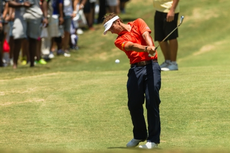 scores: Professional Golfer Joost Luiten swings to strike ball at European PGA Tournament Volvo Golf Champions Tournament play action at Durban Country Club  January 2014 South Africa
