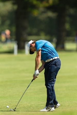 scores: Professional GolferTommy Fleetwood swings to strike ball at European PGA Tournament Volvo Golf Champions Tournament play action at Durban Country Club  January 2014 South Africa