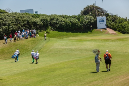 country club: Professional Golfers walking to first green at European PGA Tournament Volvo Golf Champions Tournament play action at Durban Country Club  January 2014 South Africa Editorial