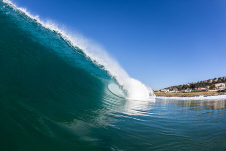 kz: Blue ocean wave with size and shape crashing towards shallow reefs and sandbanks Stock Photo