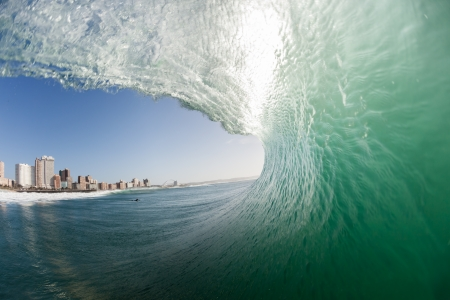 Hollow tubing crashing wave from surfing tube ride water view perspective angle