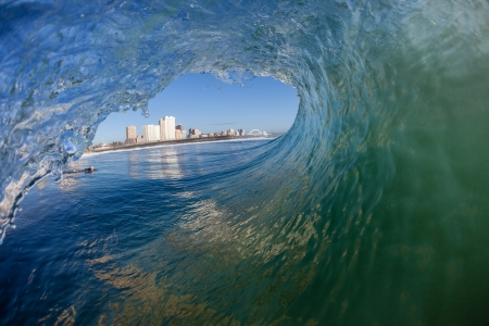 Surfers tube surfing wave view of Durban s surf city Stock Photo