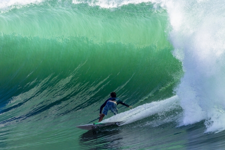 Surfing large cyclone summer waves surfer at Durban s north beach surf city  Stockfoto