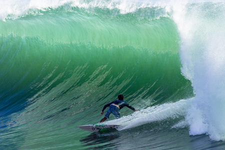 thrilling: Surfing large cyclone summer waves surfer at Durban s north beach surf city  Stock Photo