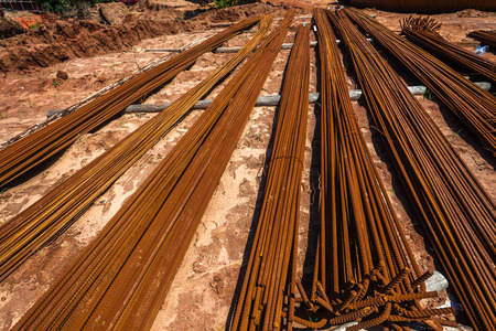 civil engineering: Civil Engineering Construction Steel metal rods lay stacked  for strength installation in concrete columns construction Stock Photo