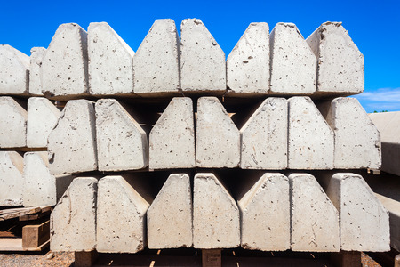 Concrete Road Corner Edges stacked for new civil construction highway road installation   Stock Photo