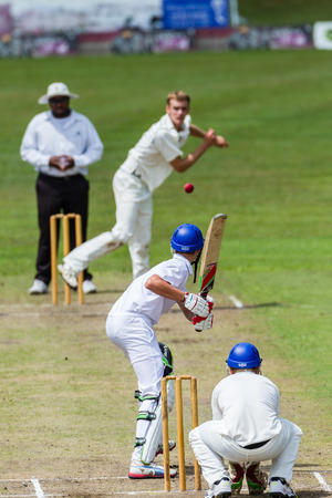 Cricket Bowler bowling towards batsman during game Westville plays Durban Boys High School 1st Teams derby Editorial