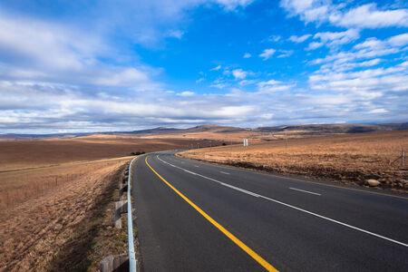 New road through rural countryside wilderness farming terrain landscape photo