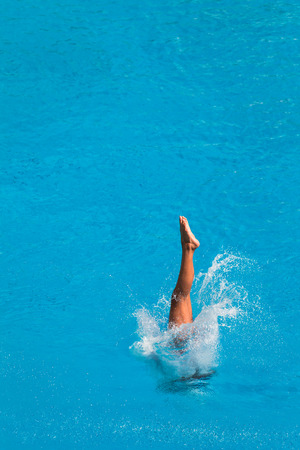 Girl in mid flight dive at national aquatic diving competition Imagens - 25708065