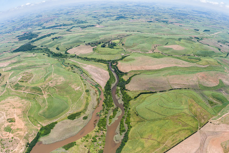 Air birds eye view of sugarcane farming fields with small rivers over the colorful landscape photo