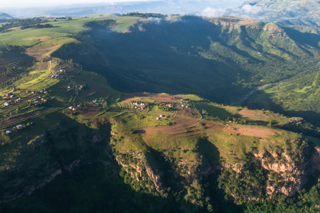 Air birds eye view of valley and hills habitat homes over the colorful landscape