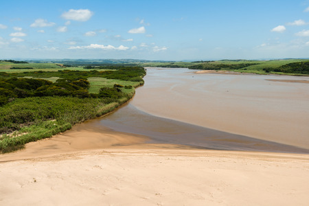 Air birds eye view of wide river beach farming fields over the colorful landscape photo