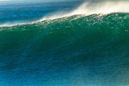 swell: Ocean wave swell wind ripple textures on waters about to crash onto shallow shoreline reefs Stock Photo