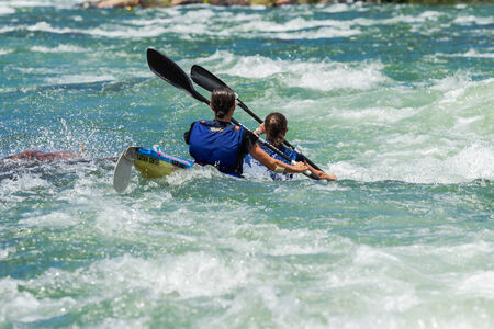Dusi canoe race action drama at Inanda Rapids with paddlers going through rushing river waters
