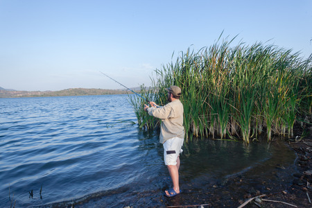 Fisherman bass fishing afternoon in dam waters  photo