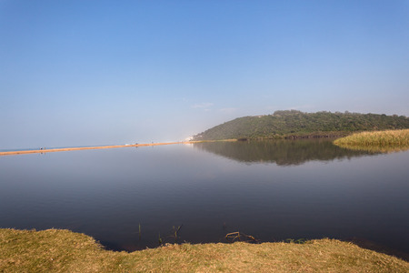 River Lagoon glass smooth waters on beach ocean sea coastline\ landscape
