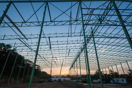 girders: Steel metal frame construction of large new building warehouse with girders beams poles bolted and welded together