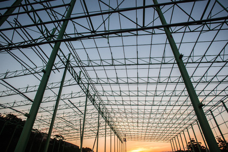 Steel frame warehouse building structure being put together piece by piece Stock Photo