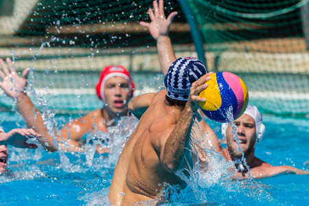 Water-polo national championships game action between province state mens teams in swimming pool Editorial