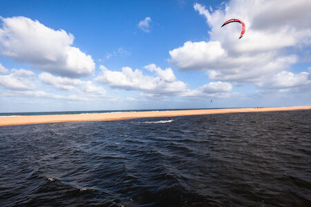 kz: Kite surfing in lagoon surf action beach river lagoon north of Durban South Africa