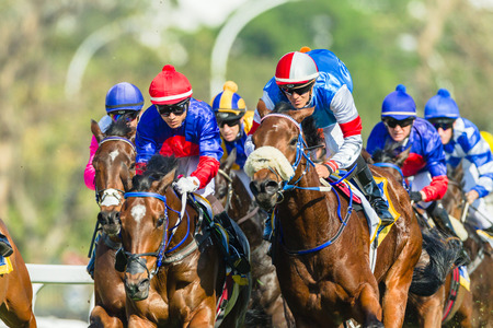 Paardenraces jockeys actie close-up op Greyville grasbaan voor Durban juli