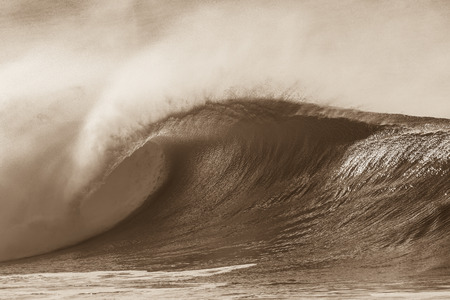 hollow wall: Ocean wave crashing curling lip in sepia vintage contrast