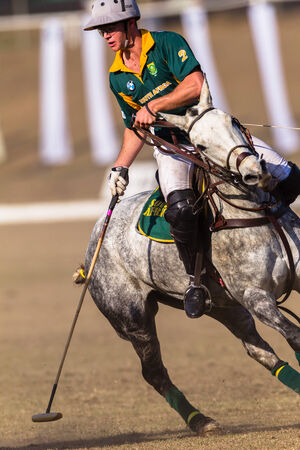 Polo game riders in action between USA and South Africa at Shongweni equestrian grounds outside Durban