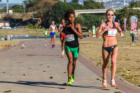 18th: Girls participating in the Spar Marathon Race Walk held along beachfront promenade. Durban South-Africa 18th Sept 2014 Editorial