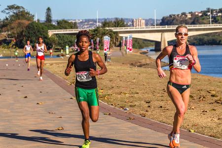 spar: Girls participating in the Spar Marathon Race Walk held along beachfront promenade. Durban South-Africa 18th Sept 2014 Editorial