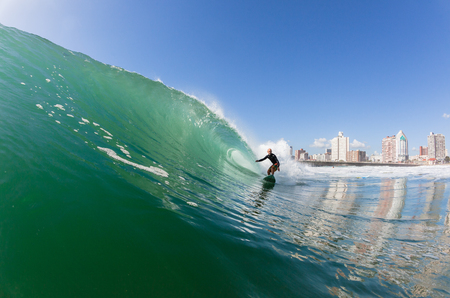 south africa: Surfing surfer rides ocean wave at North Beach Durban South-Africa