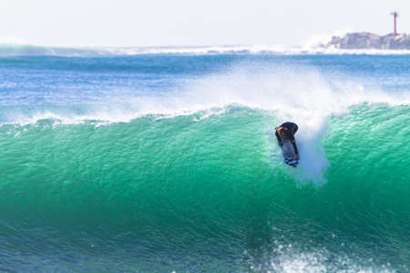 swells: Surfing surfers large storm swells of waves Durban South-Africa 3rd Oct 2014 Editorial