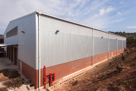 sheeting: New factory warehouse building built with metal  structure with ibr roofing cover sheeting and brick block walls