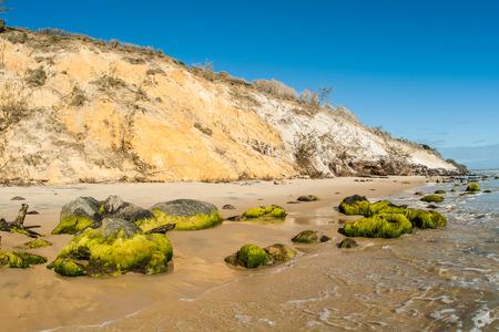 color mixing: Beach coastline rocks and sands of color mixing on coastline beach embankment at Rainbow beach Queensland Australia Stock Photo