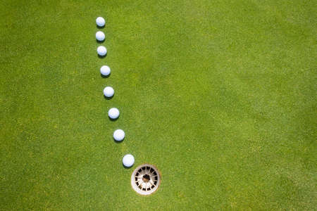 predicted: Golf putting green with balls on predicted line