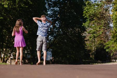 hangout: Teen girl boy hangout home talk laugh playtime walking away