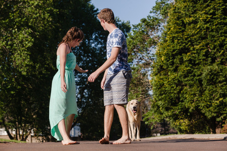 hangout: Teen girl boy hangout home talk laugh playtime walking with dog