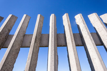 Fence section of concrete structure for security of private property photo