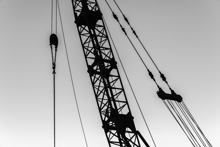 pulleys: Construction crane cables pulleys structure abstract silhouetted Stock Photo